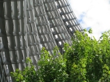 "Structural shade-providing ""shelves"" to help cool an office building."