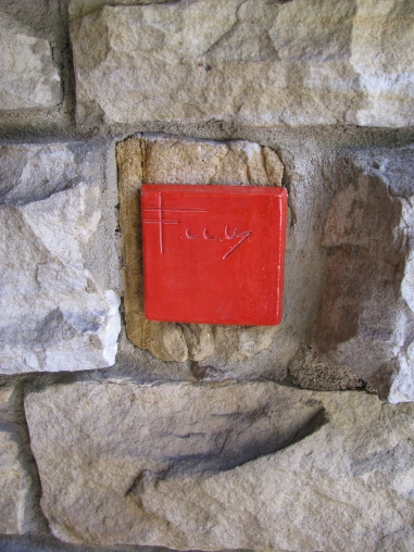 "This tile is F.L.Wright's ""signature"" on the structure."