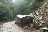 Enormous rock from last week's mud slides. We found the bit of survey tape around this huge blockade rather amusing.